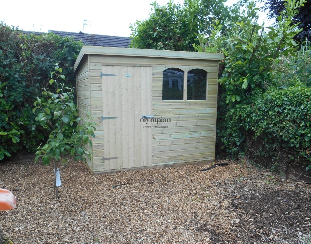 Standard pent shed on base in gravel garden in Hale Cheshire