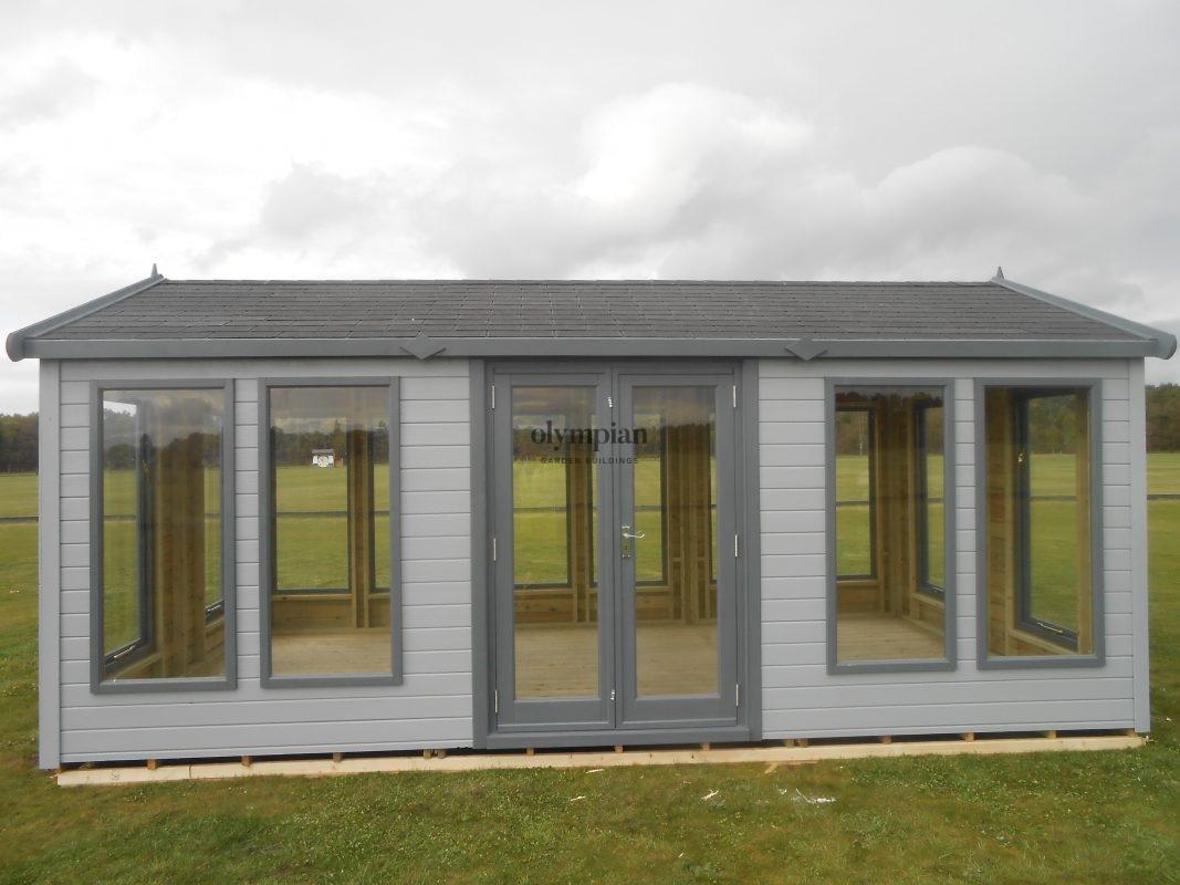Modern painted garden studio with felt shingles