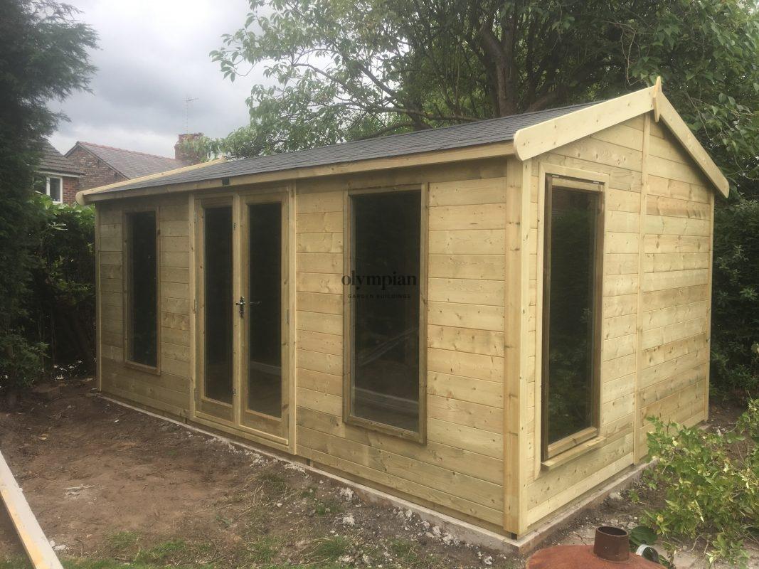 Modern garden studio with felt shingles