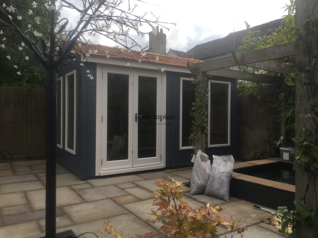 Modern painted garden studio with cedar shingles