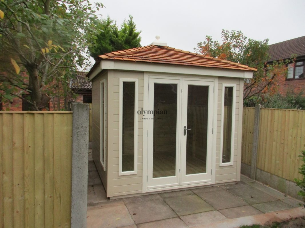 Hipped roof summerhouse with cedar shingles