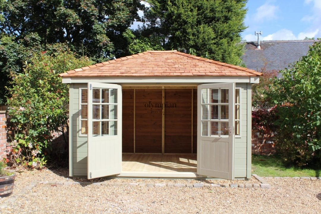 Painted hipped roof summerhouse with cedar shingles