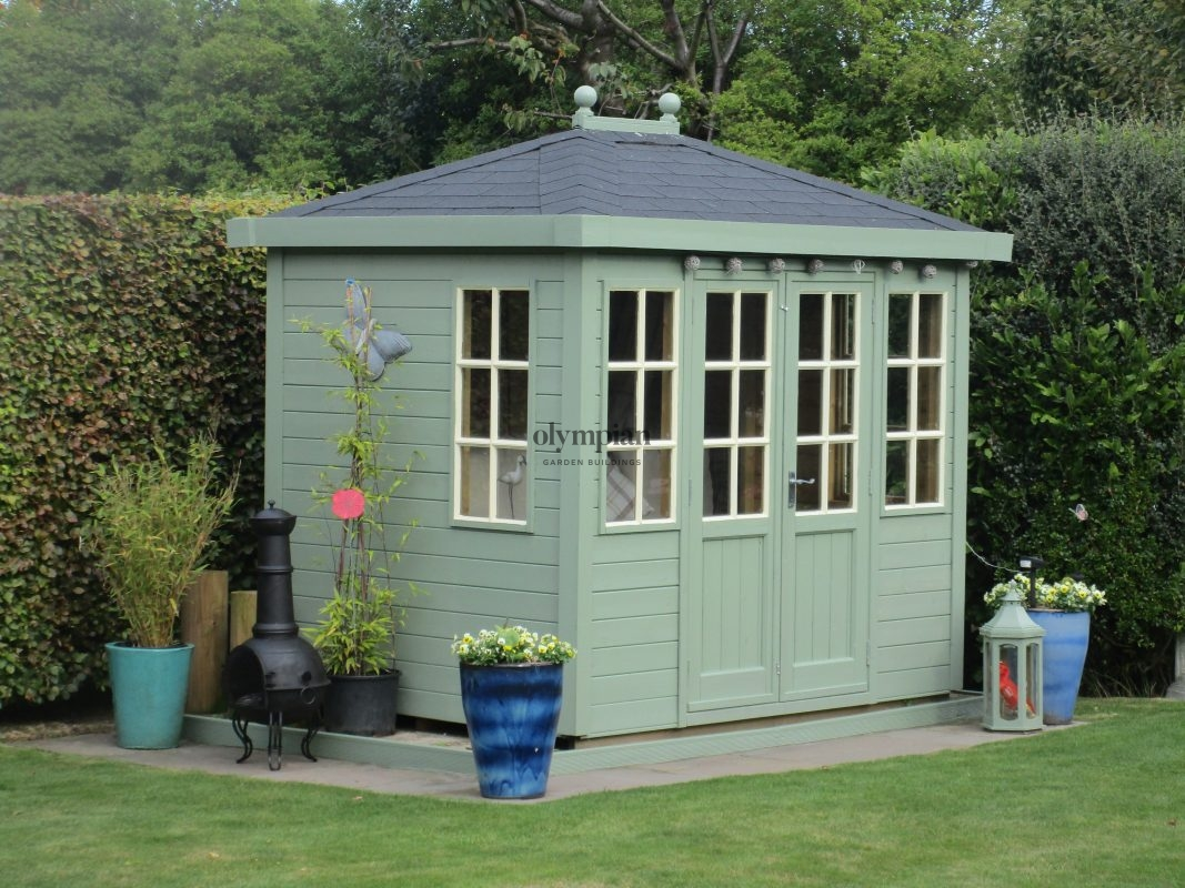 Painted hipped roof summerhouse with felt shingles