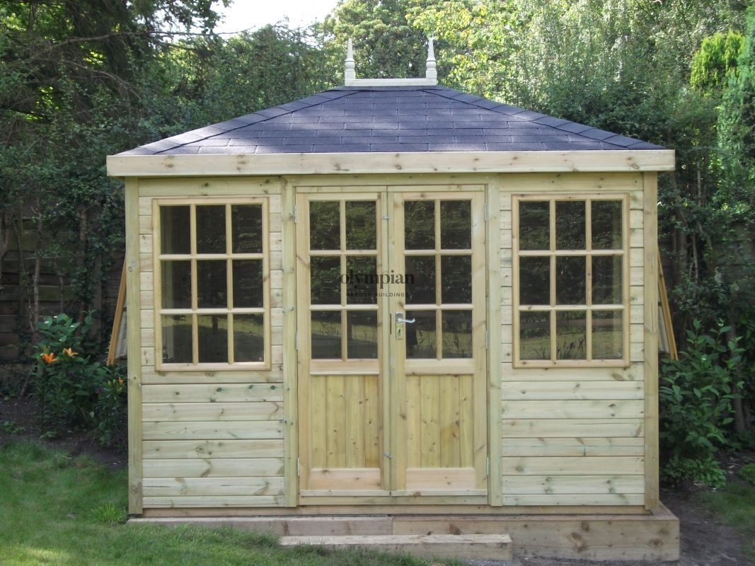 Hipped roof summerhouse with felt shingles
