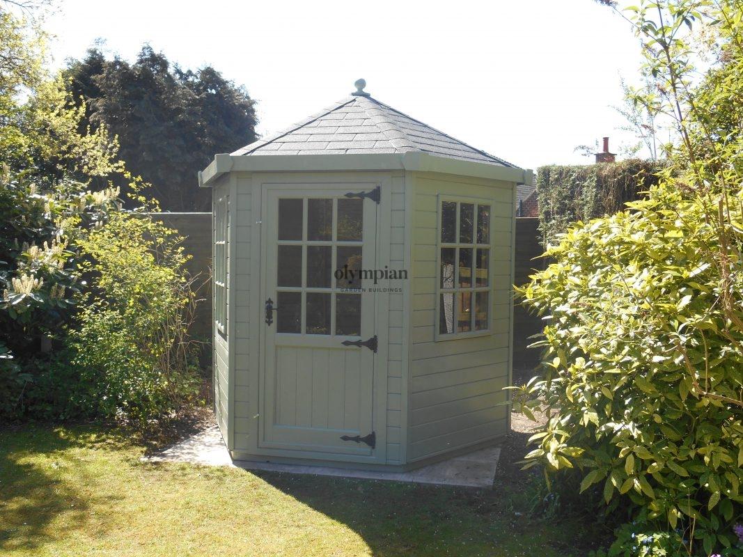 Painted hexagonal summerhouse with felt shingles