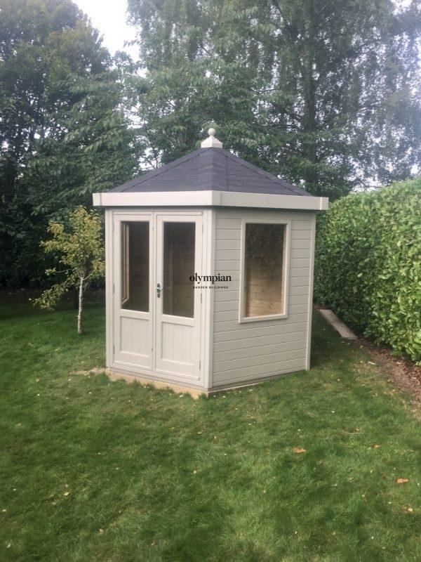 Painted hexagonal summerhosue with felt shingles and studio upgrade
