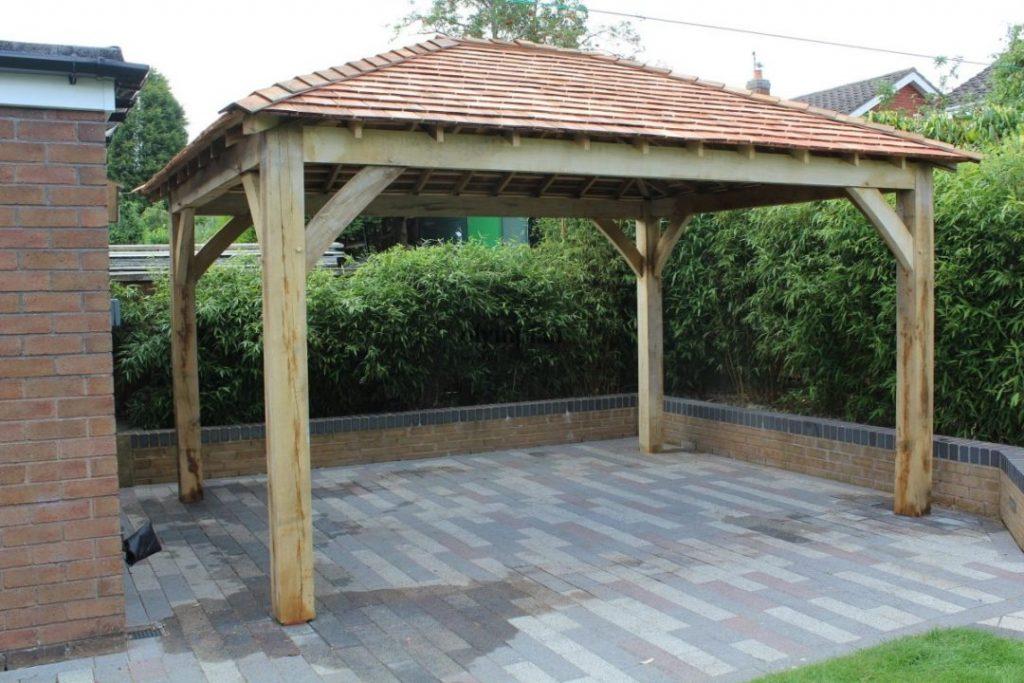 Customer review oak frame gazebo in urban garden setting
