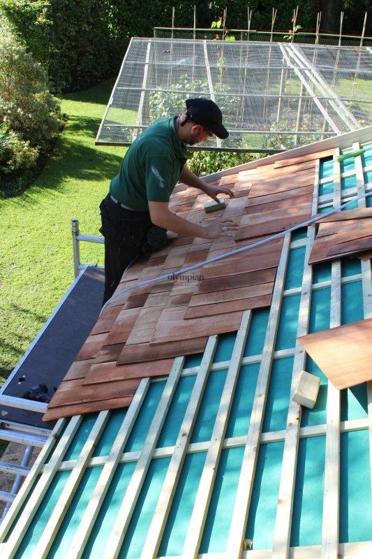 Man fitting cedar shingles